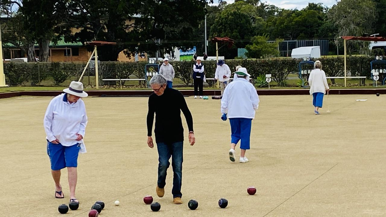BACK TO BOWLS: At Brunswick Heads Women's Bowls Club experienced player Jenny Andrews (left) and new member Lee Gleeson study the play as matches resumed.