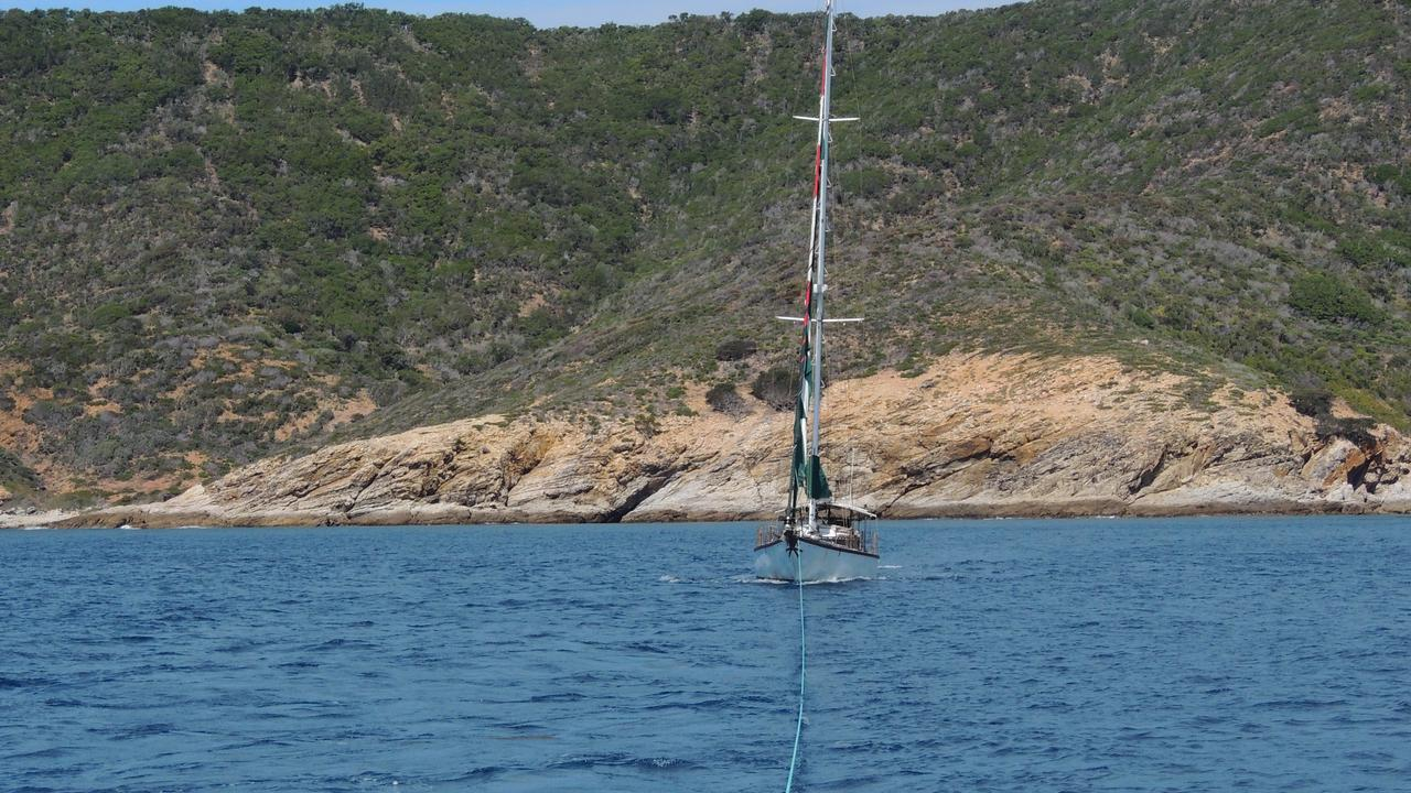 A yacht under tow from Wreck Beach, Great Keppel Island early last week.