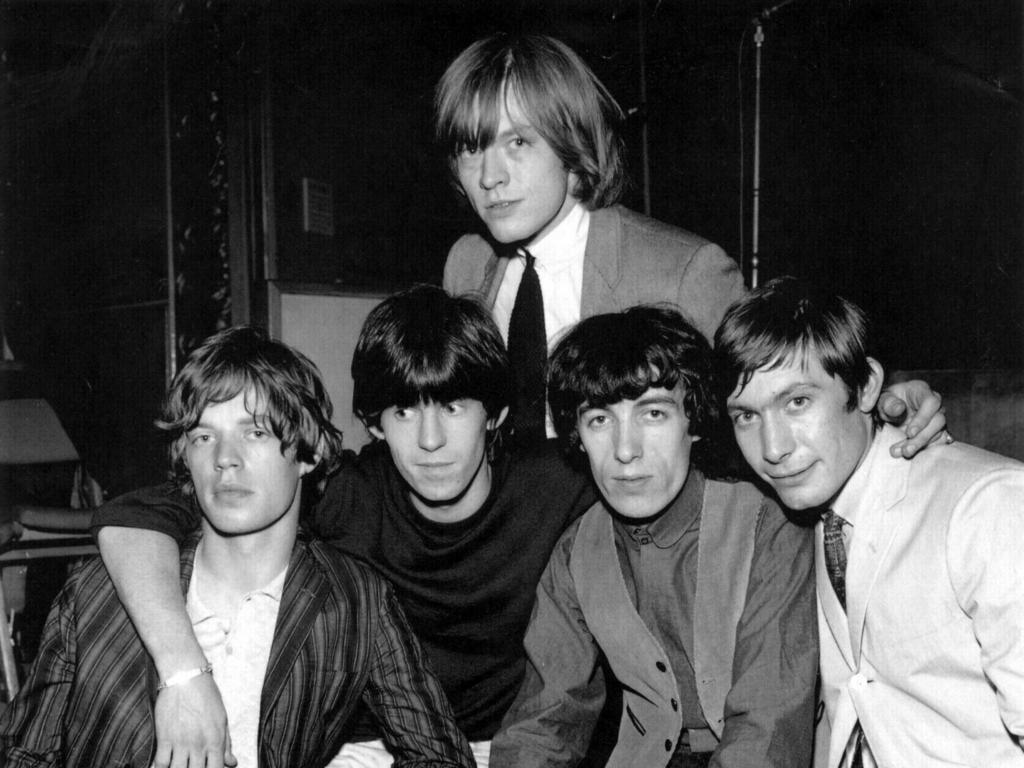 Rolling Stones co-founder Brian Jones, at back, died under mysteroius cuircumsnaces.