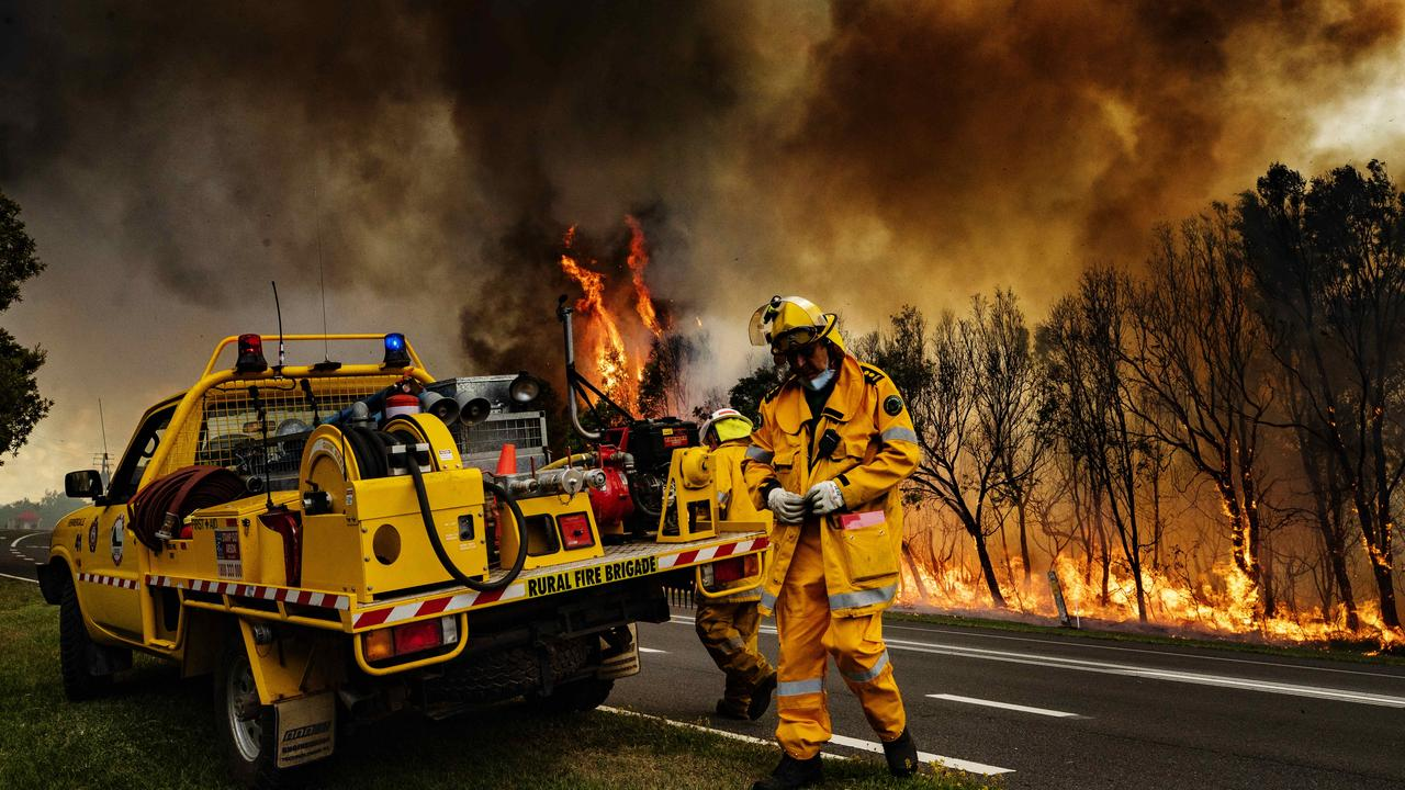 Firefighters on the scene at an out of control bushfire at Peregian Beach late last year. Photo Lachie Millard