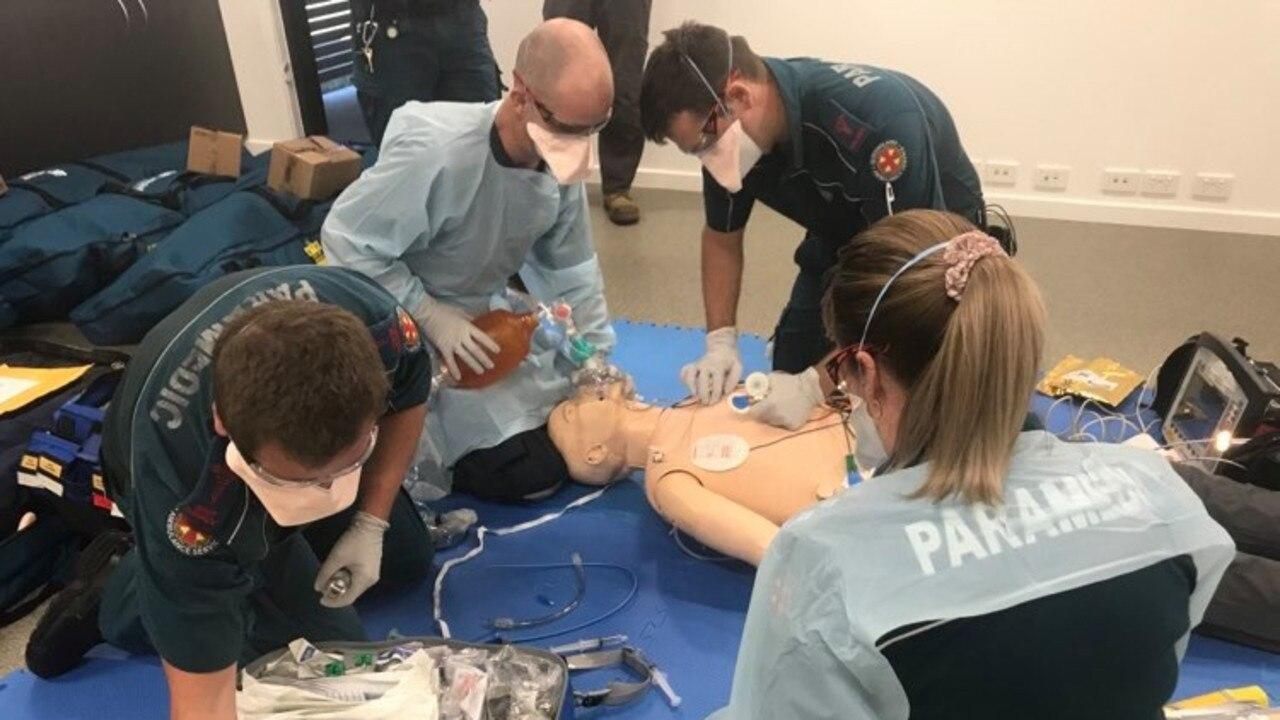 Bundaberg Paramedics simulate reviving a man who collapses.
