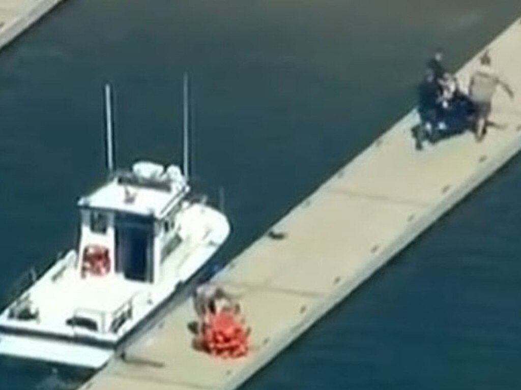 Police pictured at Lake Piru shortly before announcing a body had been found. Picture: KTLA
