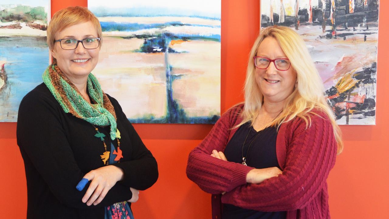 Loretta Grayson and Karina Devine can't contain their joy as their showcase the travelling exhibition. .