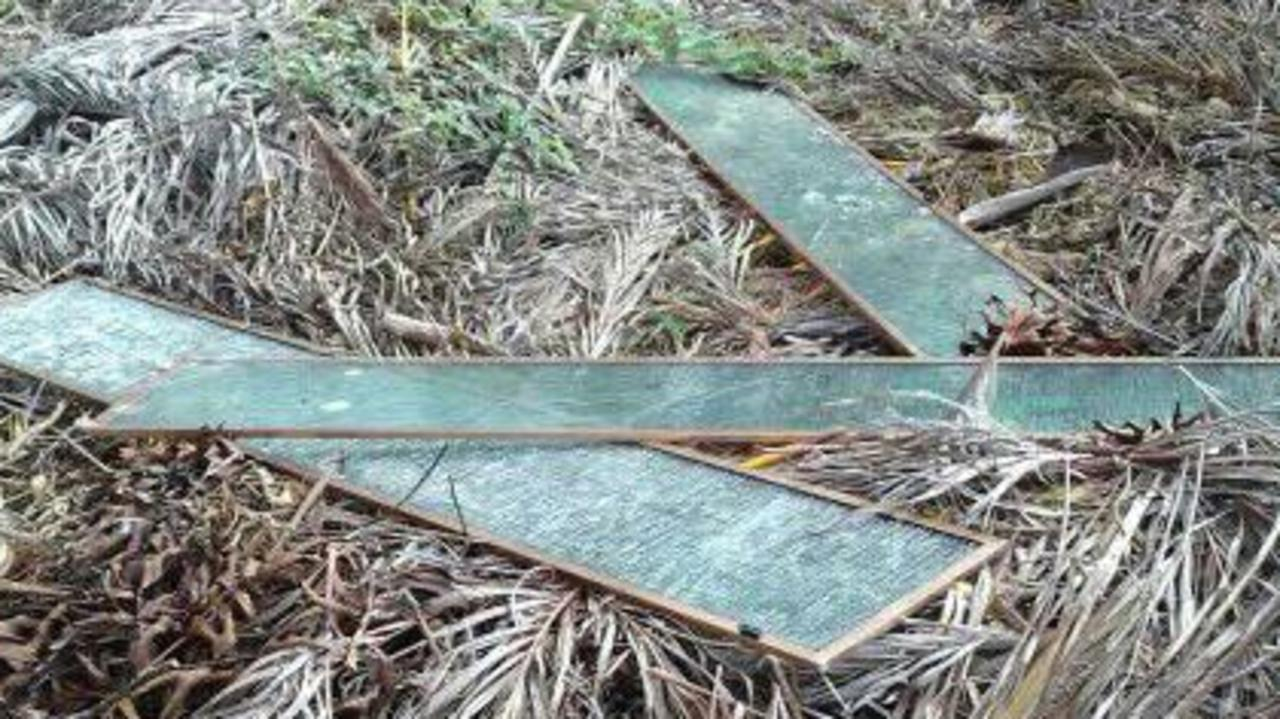 Glass panes dumped on the vacant property at Tin Can Bay. Picture: Kev Ice
