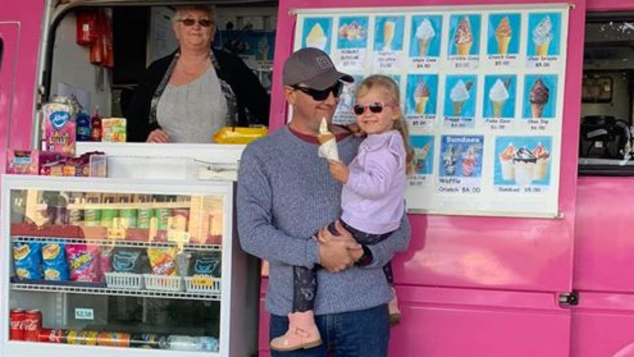 Owner of Ziffy's Frozen Yoghurt Gwen Rae with some happy customers at the weekly Sunday Seaforth Markets on Palm Ave.