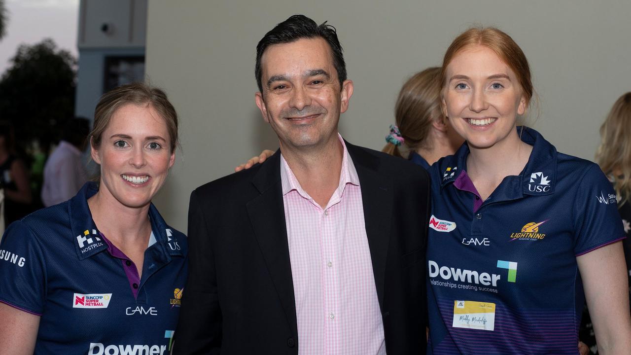 Sunshine Coast Lightning's Laura Scherian, left, and Maddy McAuliffe, right, with Sunshine Coast Council's outgoing head of economic development Paul Martins.