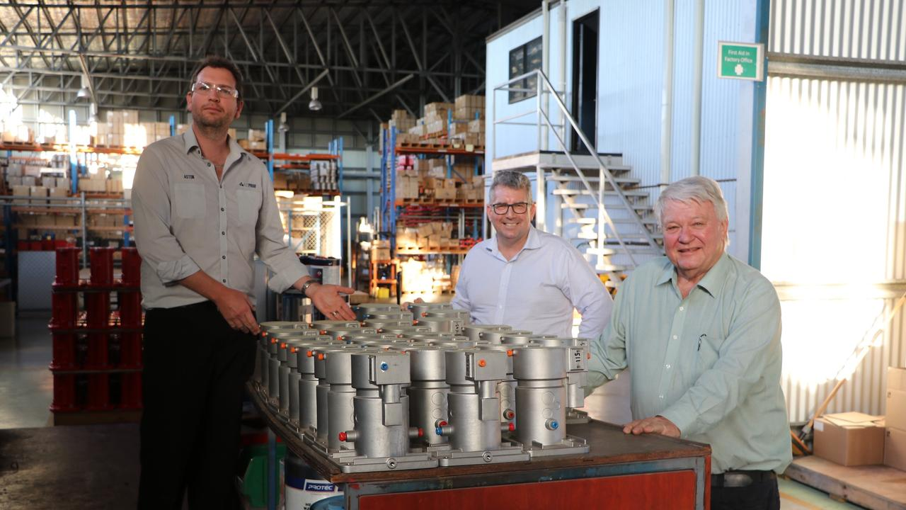 Minister Keith Pitt, Flynn MP Ken O'Dowd and Ausproof's Aston Marks at their Gladstone manufacturing facility. The company produces and exports high voltage connectors to mining companies globally.