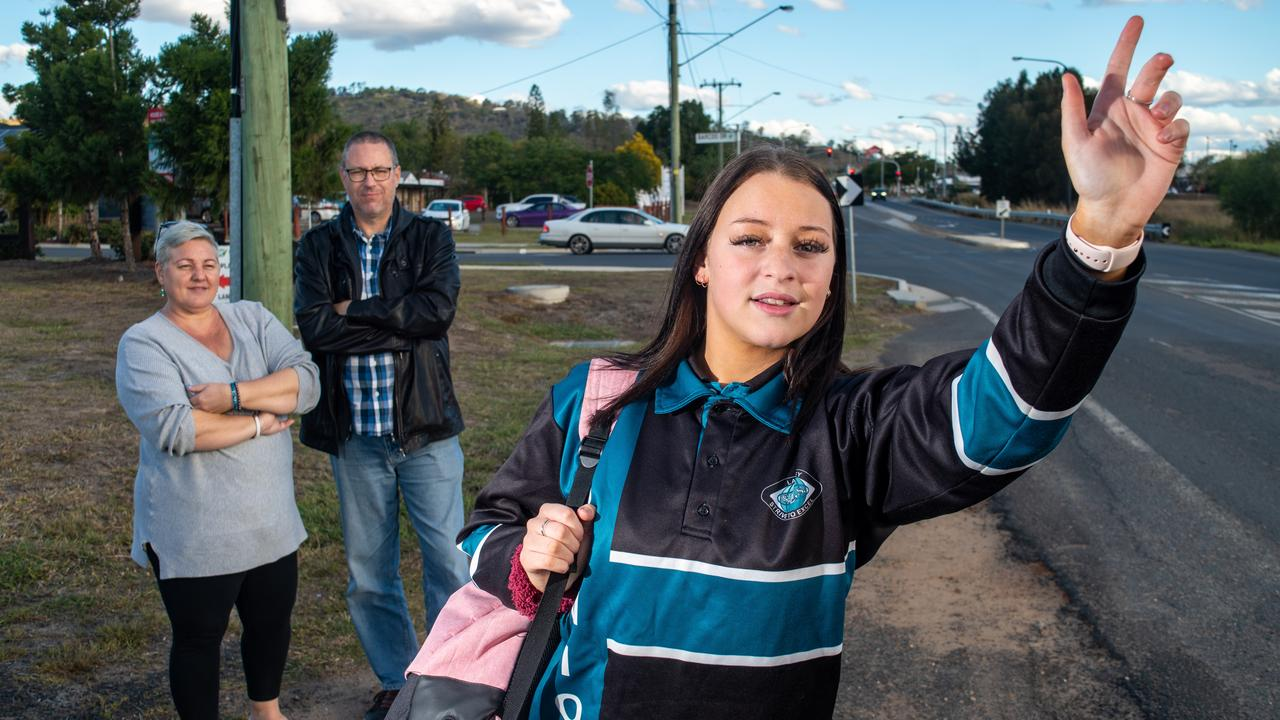 Antonia Hobart (front) with her parents Anthony and Raechell, are concerned about the student bus stop near Plainland Crossing. PHOTO: ALI KUCHEL