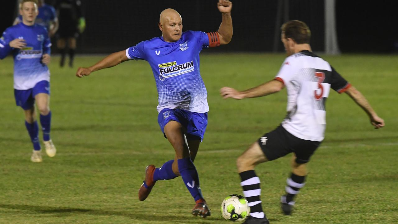 Bluebirds United's Darren Holmes and Nerimbera's Shane Burgess in action in the CQ Premier League Round 1 clash. Picture: Jann Houley.
