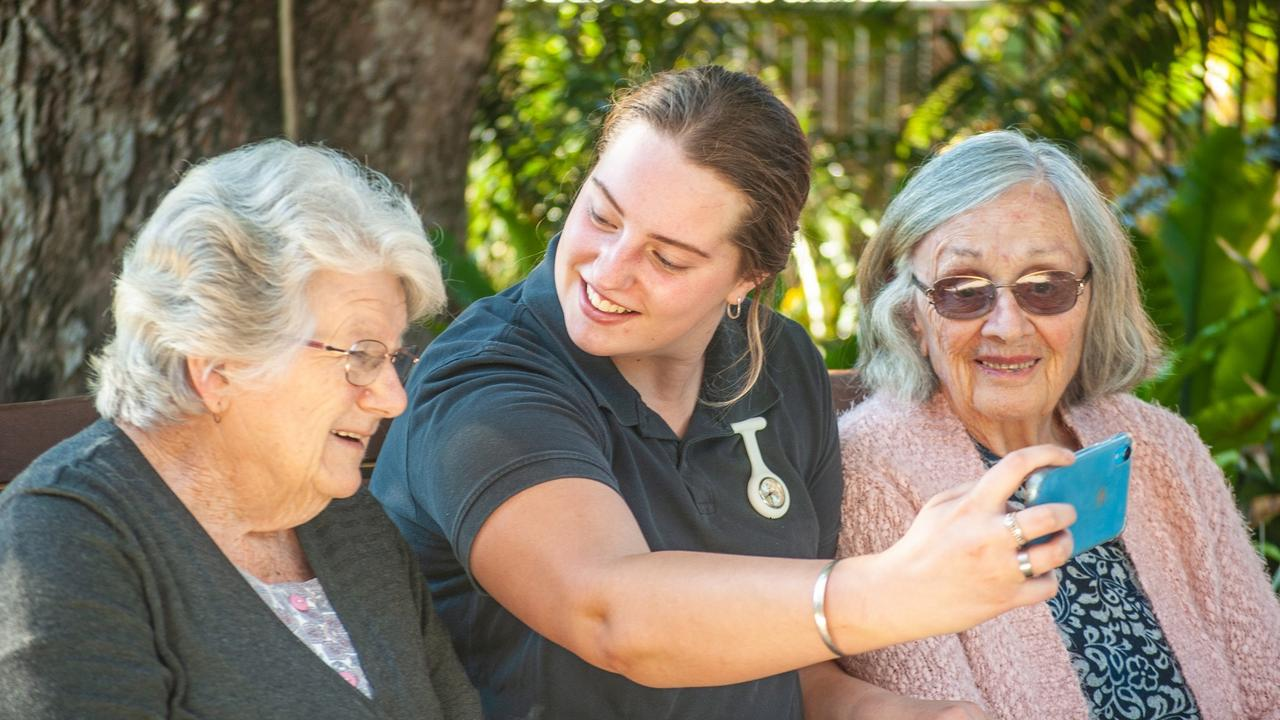 COURAGEOUS CAREER: Madeleine Thompson's dream of becoming a nurse has come true, having recently secured a permanent role as an Assistant in Nursing at St Joseph's Nursing Home in Lismore. Here she celebrates with residents Pat Hunter (left) and Mary Betteridge. Photos: Daniel Pereira
