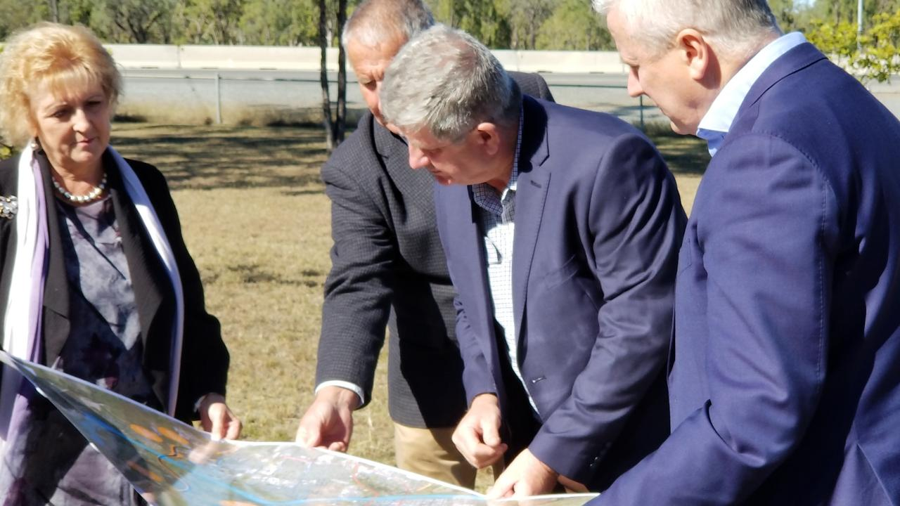 Member for Capricornia Michelle Landry, LNP Keppel candidate Adrian de Groot, LNP Rockhampton candidate Tony Hopkins, and Deputy Prime Minister Michael McCormack looking at a map of the ring road.