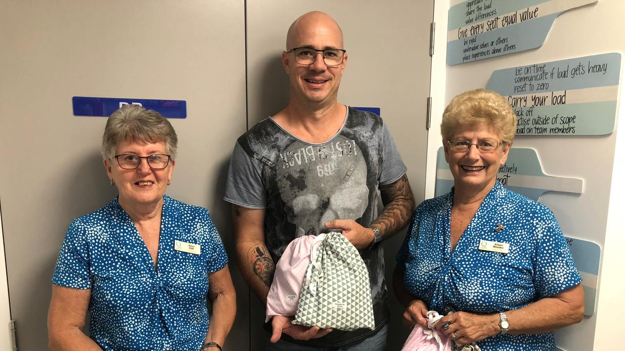 Quota Club of Gladstone Ailsa Stitt, Step Up Step Down service manager Iain Wheatley, Quota Club of Gladstone secretary Aileen Weeden donating pamper packs to mental health patient to help them with personal care.