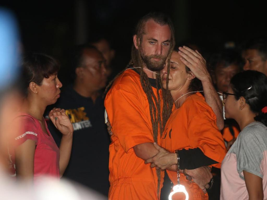 Sara Connor is comforted by David Taylor during the police re-enactment on Kuta beach. Picture: Zul Eduardo