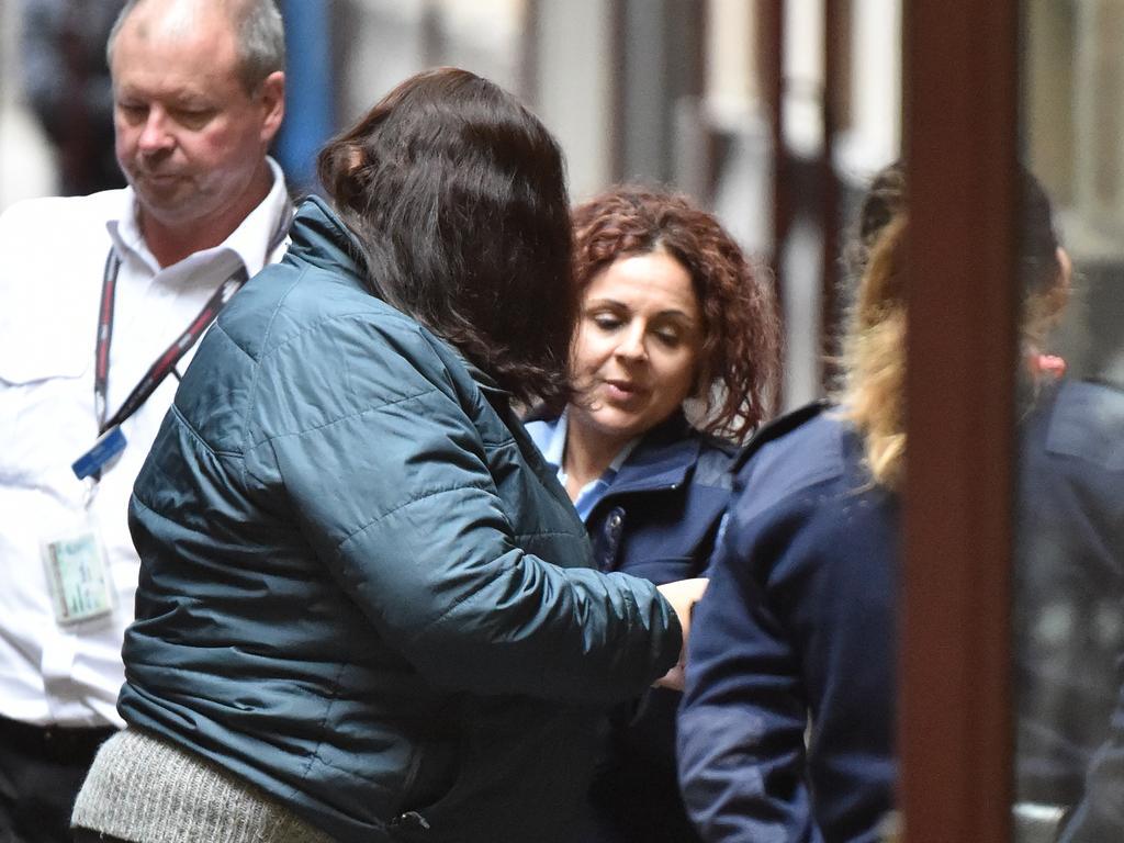 Katia Pyliotis (centre left) arrives at the Supreme Court of Victoria, Melbourne, last year. Picture: AAP Image/James Ross