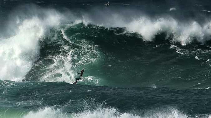 Surfers make the most of 10-metre swells