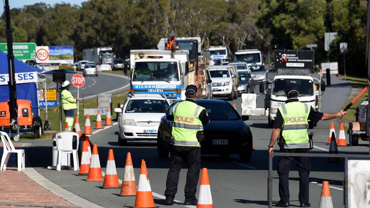 GOLD COAST, AUSTRALIA - NewsWire Photos JULY 15, 2020: Police check cars at the Queensland border with NSW at Stuart Street at Coolangatta. Picture: NCA NewsWire / Steve Holland
