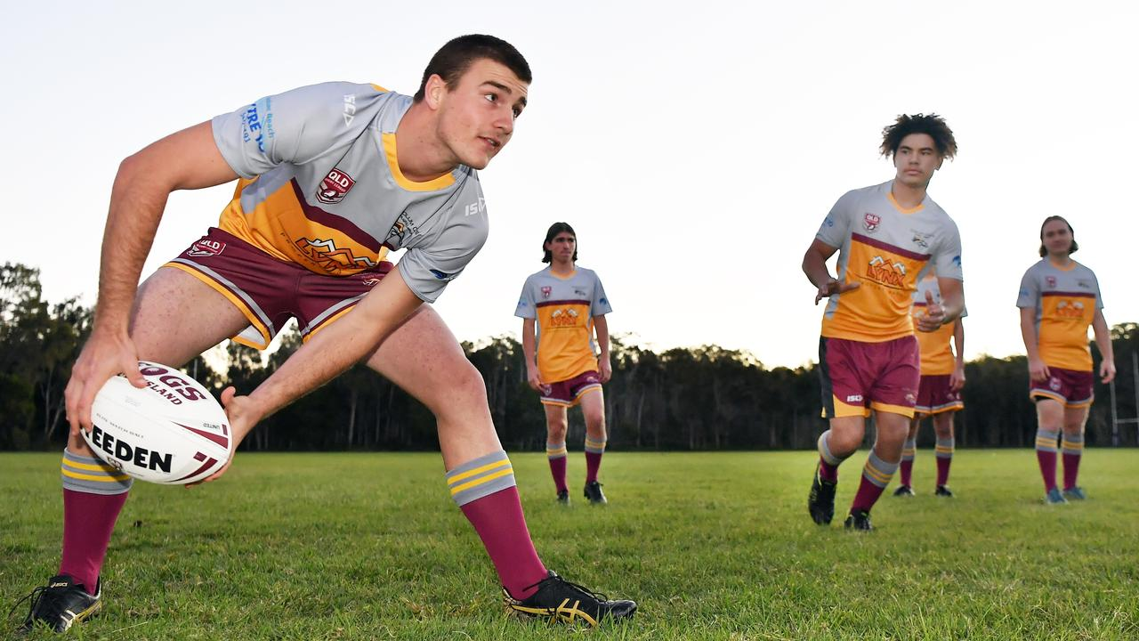LEAGUE: U18s will get a season in after junior league agreed to let them be part of junior association. Pictured, Jesse Page offloads the ball. Photo Patrick Woods / Sunshine Coast Daily.
