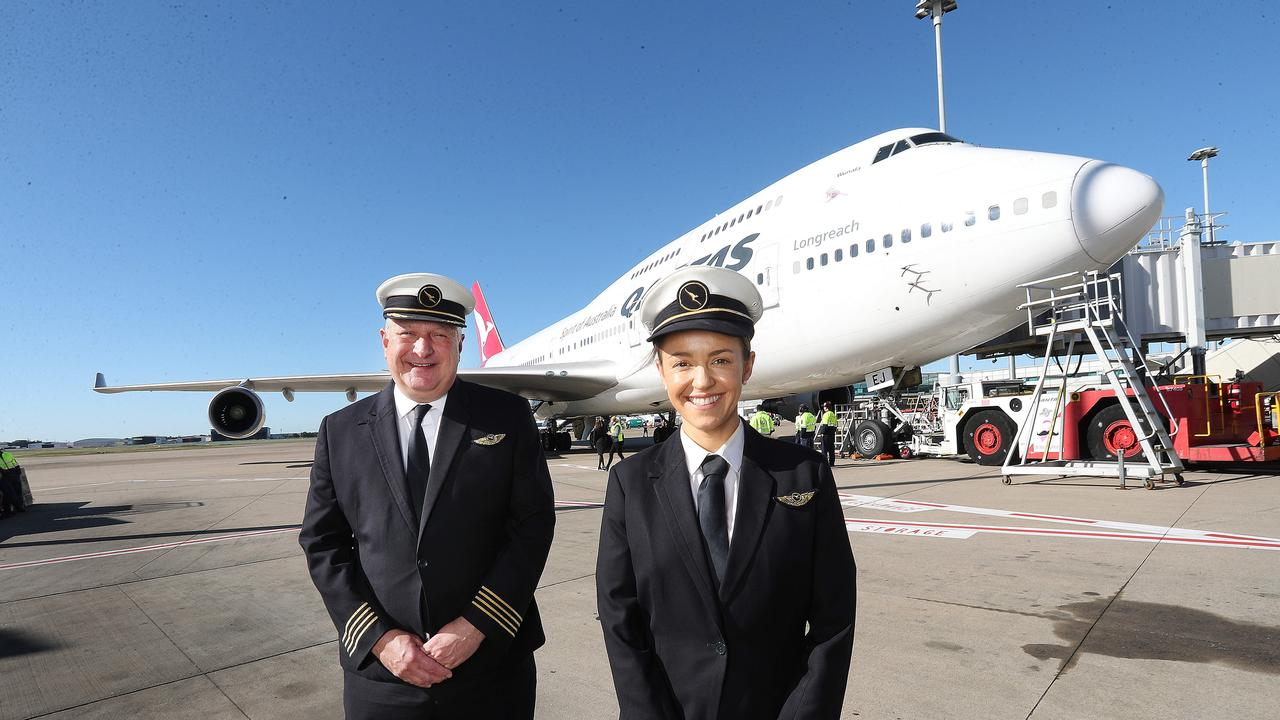 Captain Marty Gardiner from Sydney and Bree Linton from Brisbane on the Tarmac in Brisbane for the last flight for the Qantas 747. Picture: Annette Dew
