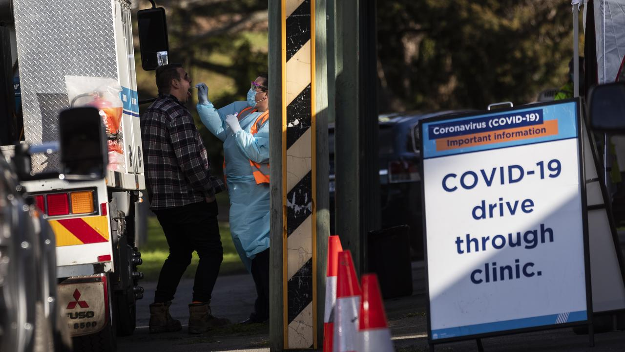 Tests are carried out at a pop-up COVID-19 testing clinic in Sydney. Twenty-eight confirmed COVID-19 cases have also now been linked to the Crossroads Hotel in the south-west Sydney suburb of Casula. (Photo by Brook Mitchell/Getty Images)