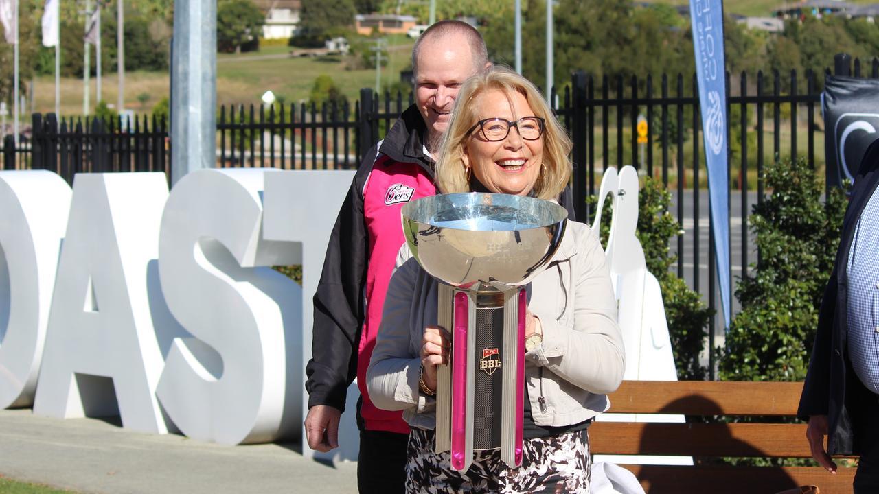 CHCC Mayor Denise Knight holds up the Big Bash League trophy at C.ex International Stadium this morning.