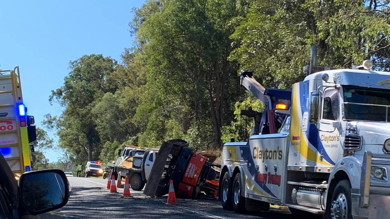 An excavator landed on the front of a Ute on the Mary valley Highway this morning. Photos: Maddie Manwaring