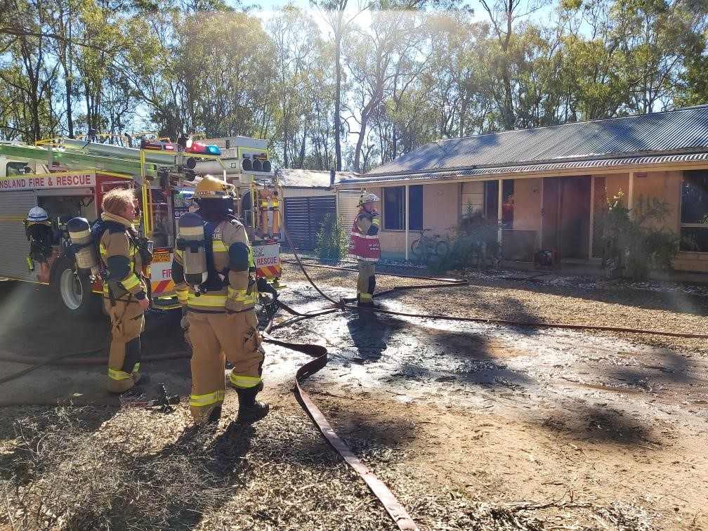 Fire fighters on scene at a house fire in South Nanango on July 16, 2020.