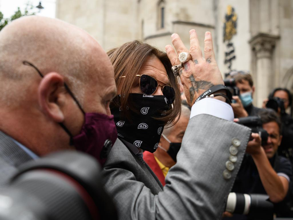 Depp was flanked by cameras as he arrived at the Royal Courts of Justice, Strand in London. Picture: Getty Images