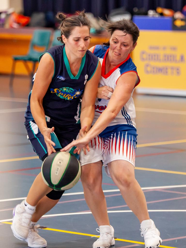Gympie Basketball women's grand finals - Naomi Lally collides with Kiah Monk at mid court. Photo: Miguel Galy