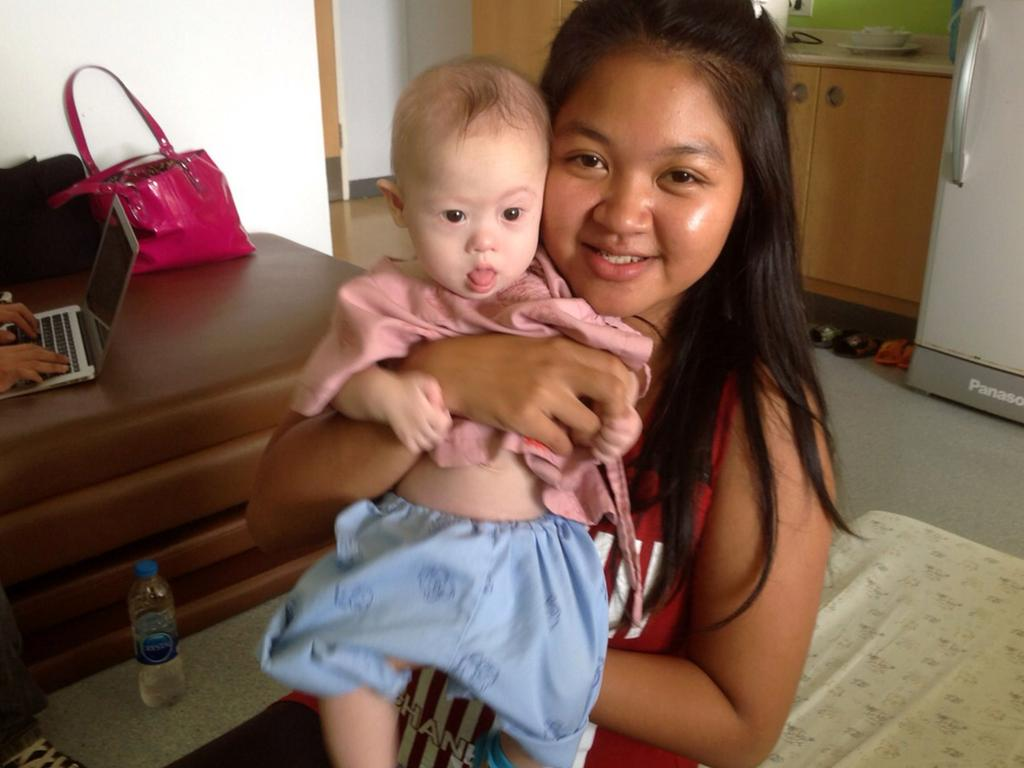 Thai surrogate mother Pattaramon Chanbua poses with baby Gammy at the Samitivej Hospital on August 6, 2014. Picture: Getty Images