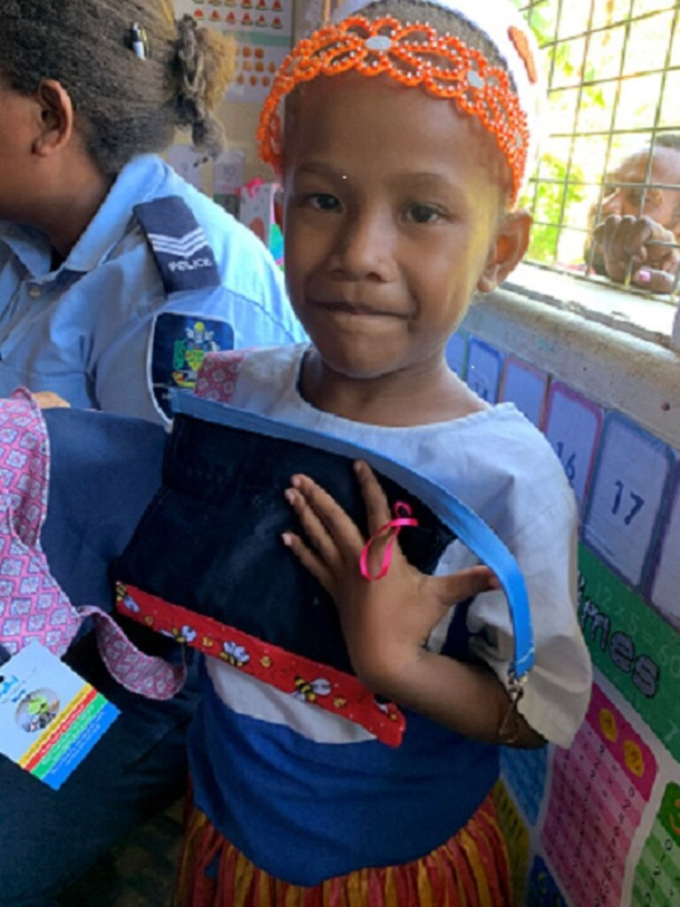 One of the delighted Solomon Island students Maddie with her very own U4kids pencil case.