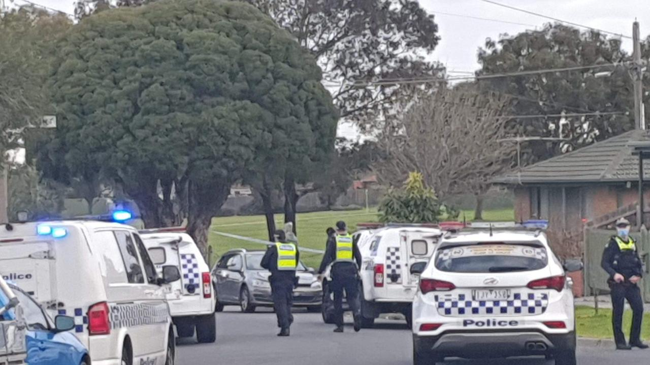 A quiet suburban street is swarming with officers after police shot dead a man just moments after he unleashed a frenzied stabbing attack on a woman.