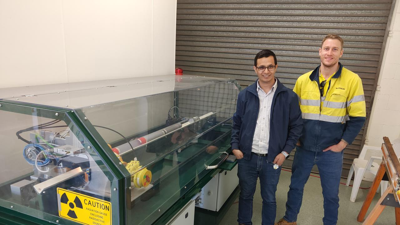 Carbon Link senior scientist Thakur Bhattarai and general manager Chris McCosker with the soil condition analysis scanner developed in Gladstone. Picture: Rodney Stevens