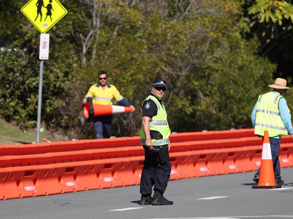 Police observe workers setting up barriers in Dixon Street, Coolangatta. Picture: Nigel Hallett