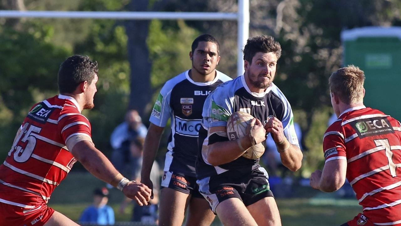 Ballina's Robby Miles heading towards Ben Webber at full pace during the Ballina v Byron Bay NRRRL Grand final. September 14, 2014. Photo: Nolan Verheij-Full / Northern Star.