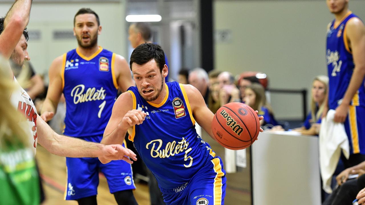 Brisbane Bullets take on Illawarra Hawks in a pre season basketball match at USC Stadium in 2018. Bullets player Jason Cadee strong in attack.