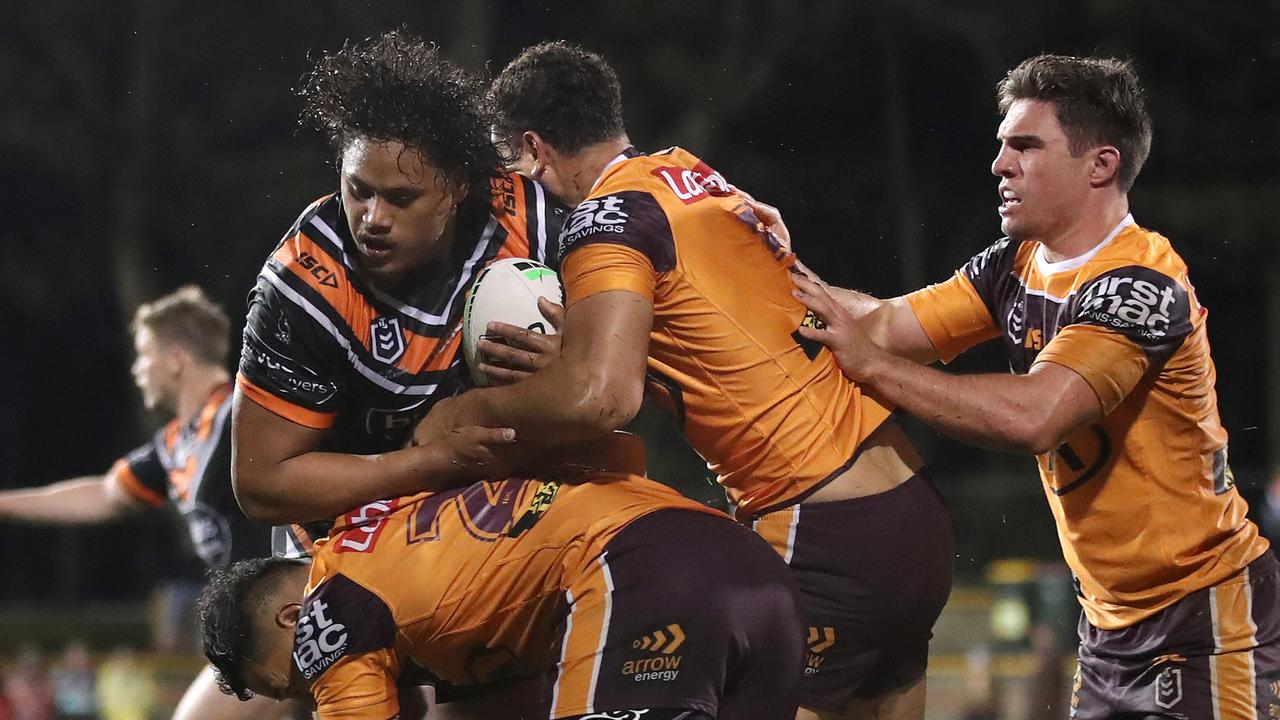 Luciano Leilua is wrapped up the Broncos' defence. Picture: Getty Images