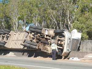 Driver trapped as truck overturns on M1