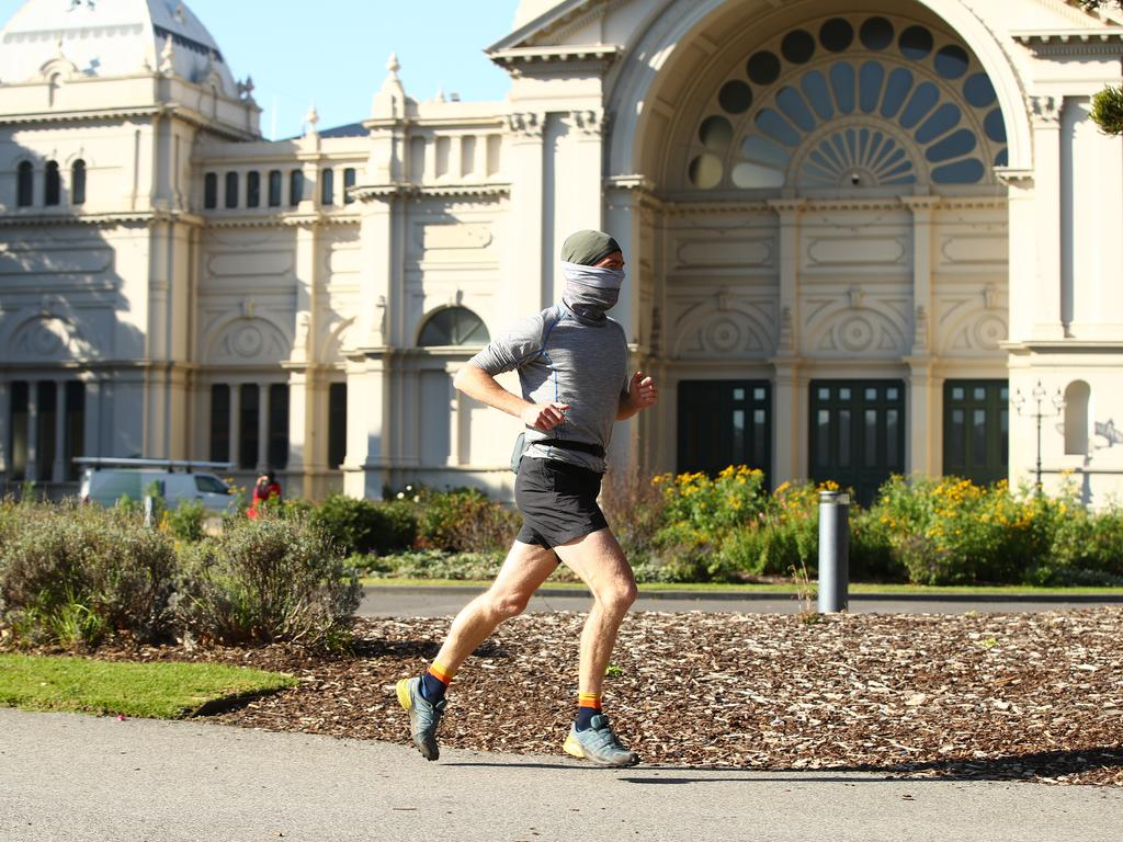 A man runs through the Carlton Gardens in Melbourne yesterday. Picture: Robert Cianflone