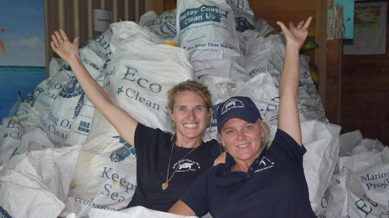 Eco Barge Clean Seas project co-ordinator Fiona Broadbent and founding chairperson Libby Edge with some of the many bags of plastic bottles collected from Whitsunday beaches.