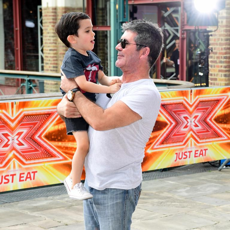 Cowell's wound down his partying ways and is a devoted dad to son Eric. Picture: Getty