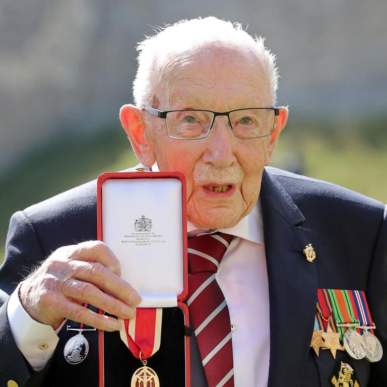 The newly honoured Captain Sir Thomas Moore poses after being awarded with the insignia of Knight Bachelor by the Queen. Picture: Chris Jackson/Getty Images)