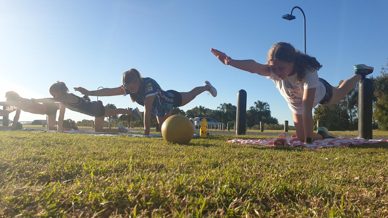 Amelia Williams and Abby-Rose Churchward have enjoyed strength training in the park with their squad mates while the pool has been closed.