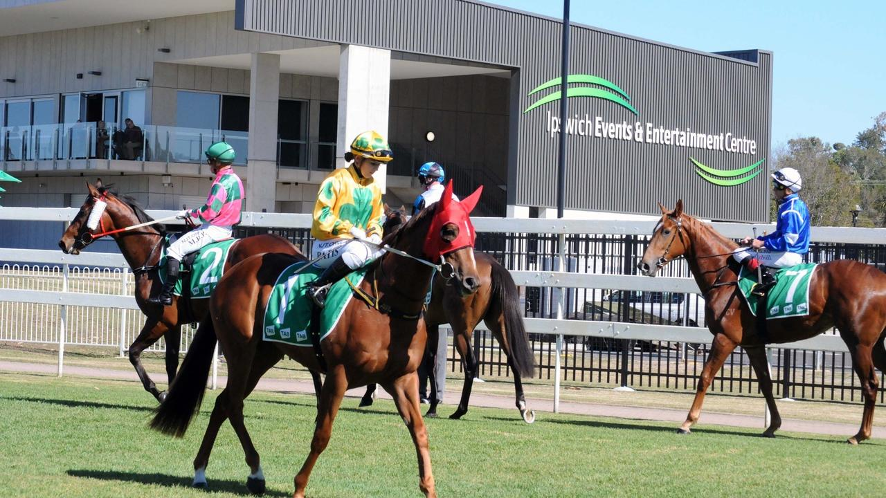 Jockeys prepare their horses in front of the impressive Ipswich Events and Entertainment Centre and new jockeys rooms at the Ipswich Turf Club. Picture: Claire Power