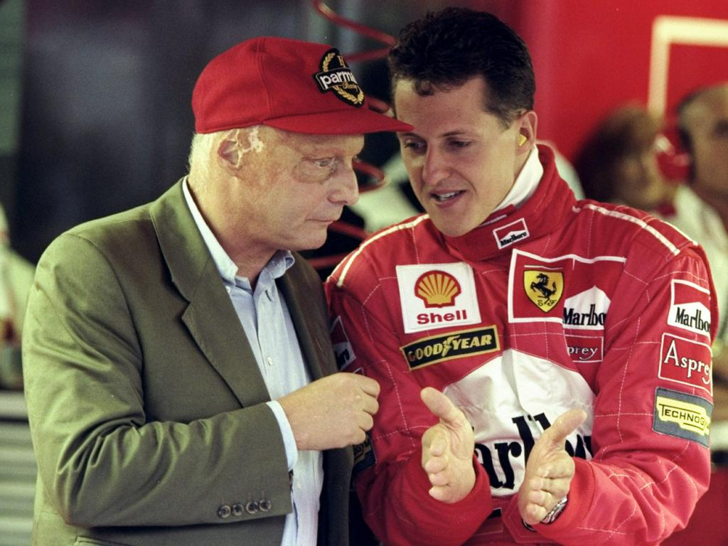 Legends Niki Lauder and Michael Schumacher.