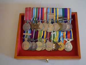 Why Long Tan legend chose this resting place for medals