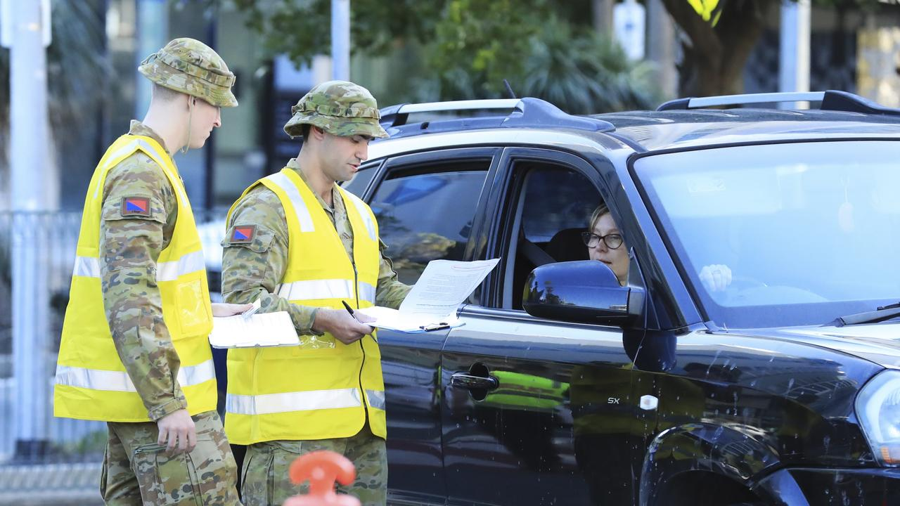 Australian Defence Force personnel assist Queensland police at the Griffith St checkpoint. Picture: Scott Powick.