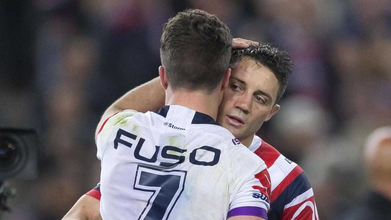 Cooper Cronk hugs Brodie Croft after the 2018 grand final.