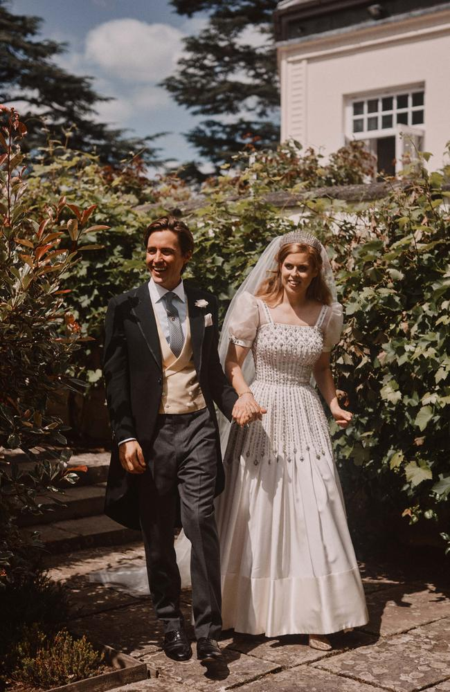 Princess Beatrice and Edoardo Mapelli Mozzi walk hand-in-hand following their wedding. Picture: Benjamin Wheeler via Getty