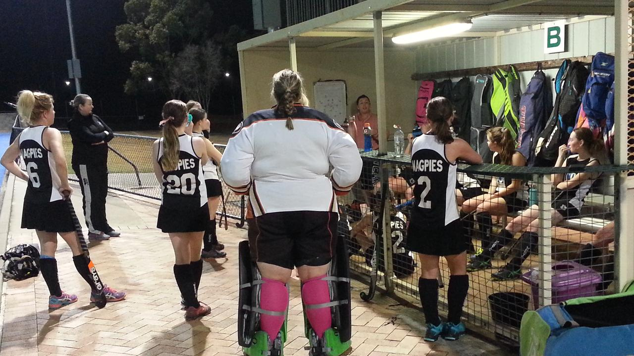 Wests A-Grade hockey players listen intently to head coach Jade Close at halftime in their latest match. Picture: David Lems