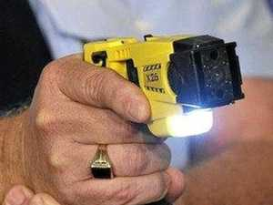 Police taser man after officer threatened with timber